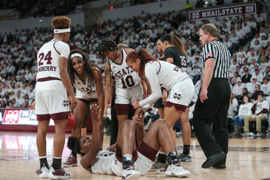 Mississippi State's Teaira McCowan (15) gets help from her teammates after a hard foul. Mississippi State played as a team against South Carolina with multiple players rising to the occasion in a huge midseason win. Photo by Keith Warren