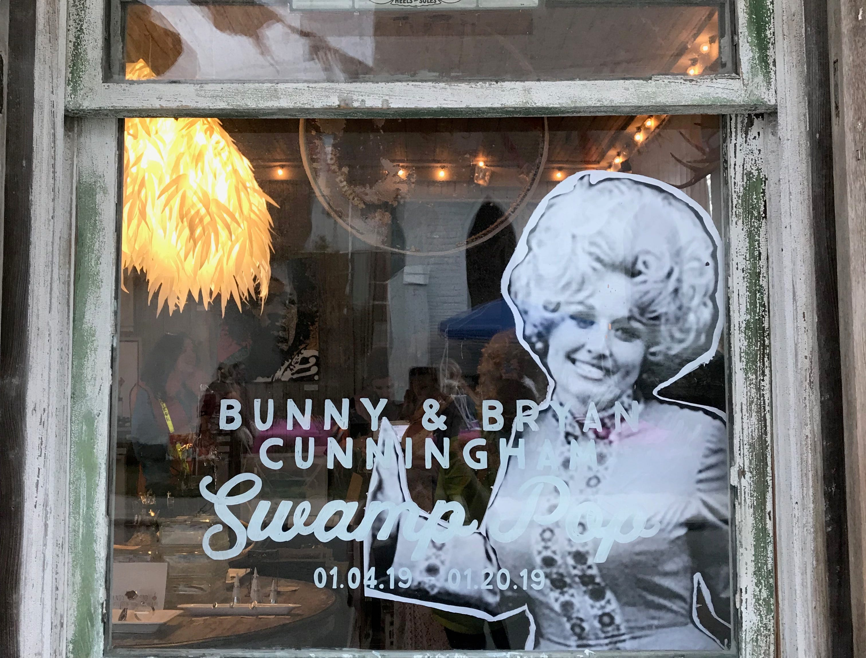 A cutout image of singer Dolly Parton is displayed prominently in the window of Smith & Lens gallery during the 4th annual Dolly Should festival held in Bay St. Louis. Saturday,  Jan. 12, 2019.