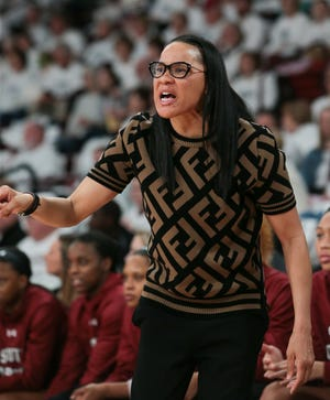 South Carolina head coach Dawn Staley  yells instructions to her team in the first quarter of Mississippi State's win over the Gamecocks. Photo by Keith Warren