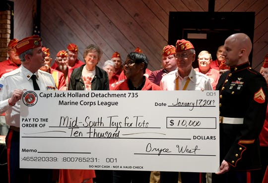 Members of the Captain Jack Holland Detachment 735 present a $10,000 check to Mid-South Toys for Tots, Thursday, Jan. 17.