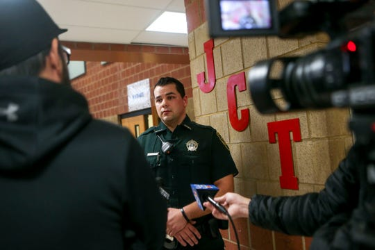 Sheriff's deputy William Haley answers questions from the media before unveiling a new washer and dryer donated to Jackson Careers and Technology Middle School  in Jackson, Tenn., on Friday, Jan. 18, 2019.