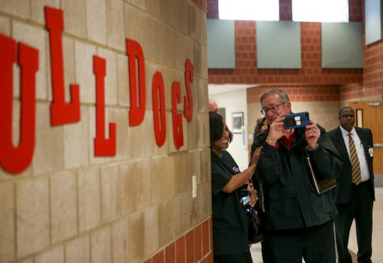 Sheriff PIO Tom Mapes jokes with Rhonda Heard, community engagement coordinator for JMCSS, while snapping photos of deputy William Haley being interviewed by the media at Jackson Careers and Technology Middle School  in Jackson, Tenn., on Friday, Jan. 18, 2019.