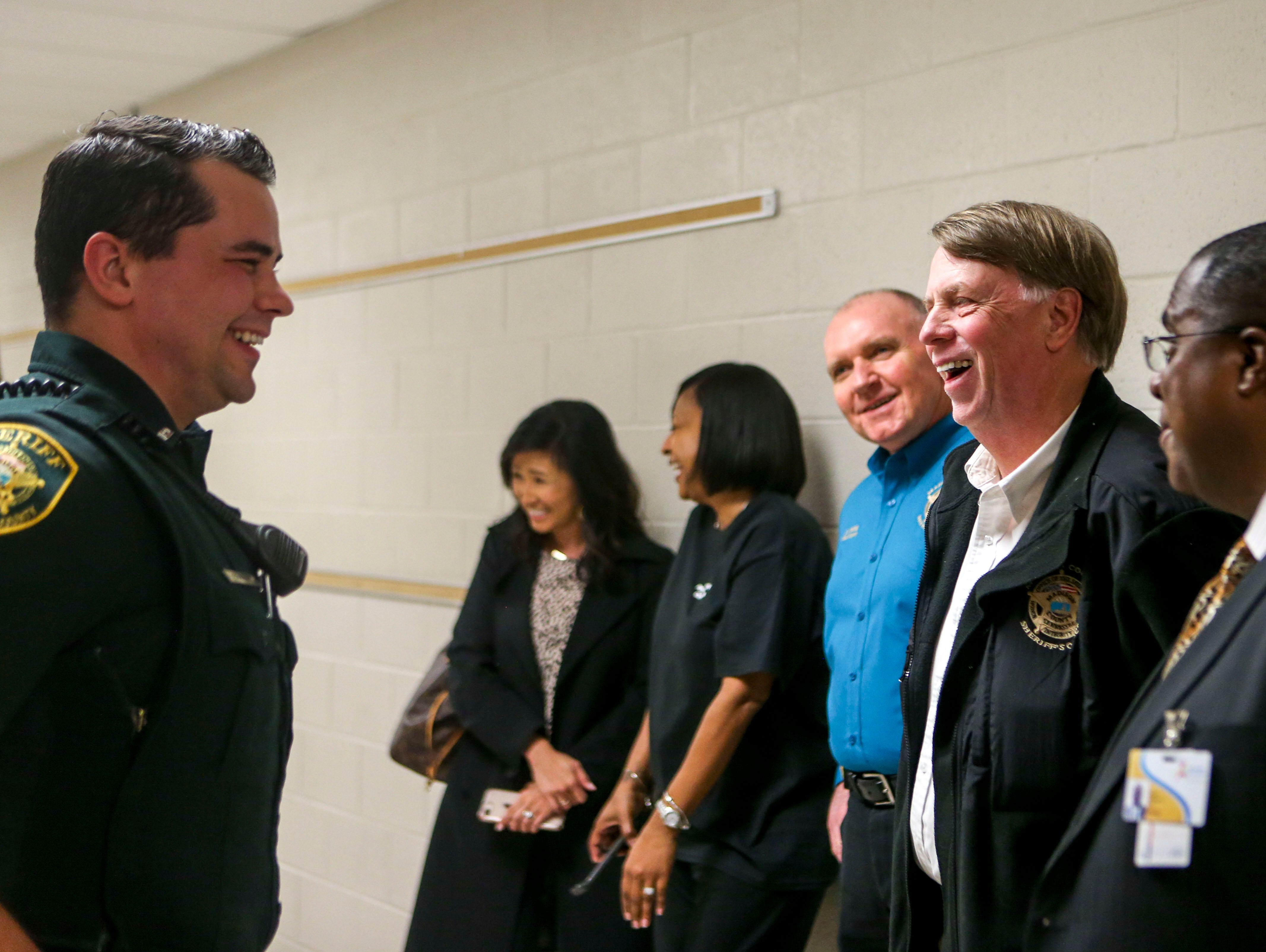 Sheriff John Mehr, right, and deputy William Haley, left, speak with J.C.T. Middle School Principal James Walker at Jackson Careers and Technology Middle School  in Jackson, Tenn., on Friday, Jan. 18, 2019.