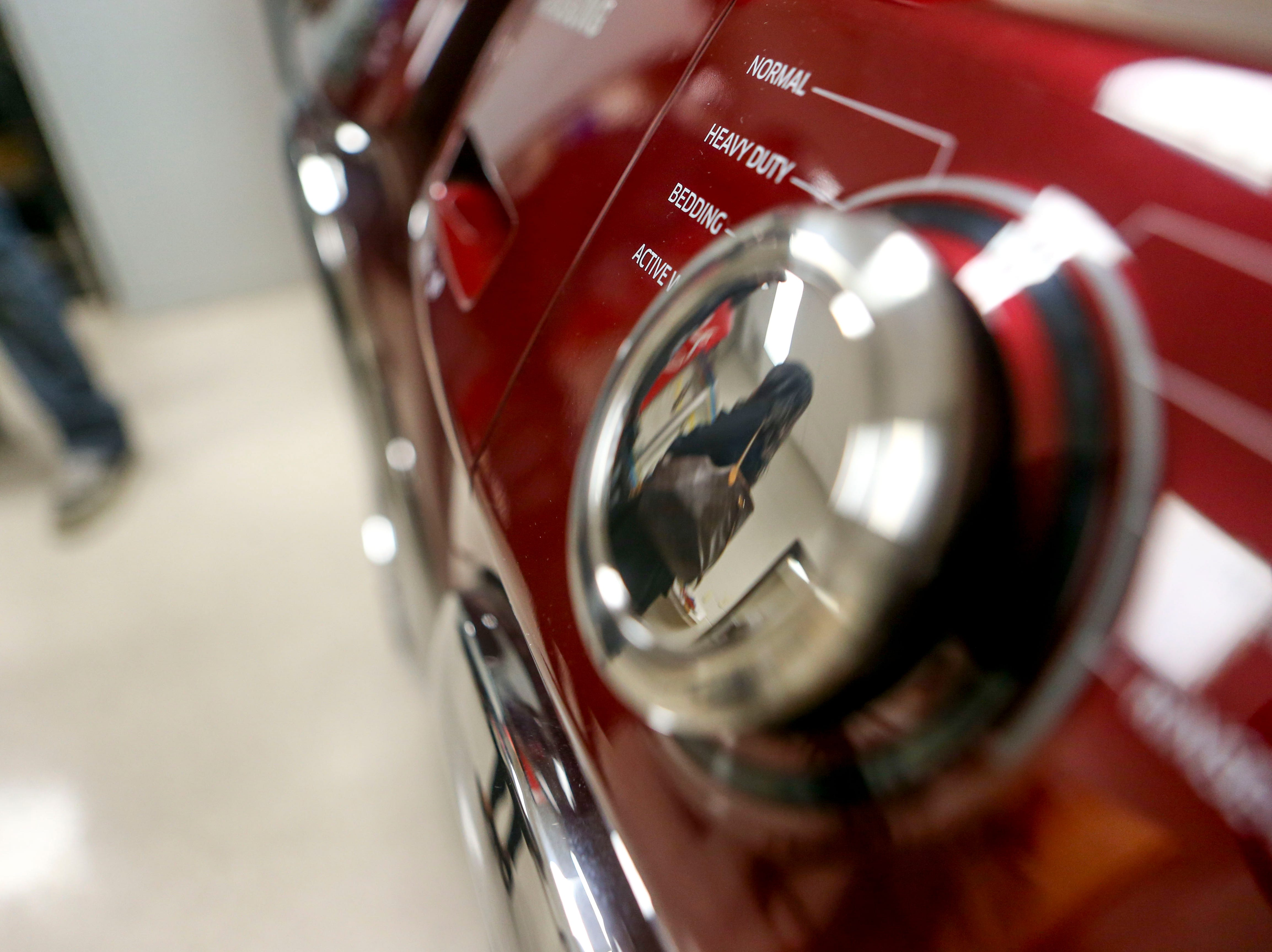 Spectators can be seen in the reflection of the dial on a new washer that was donated to the Jackson Careers and Technology Middle School  in Jackson, Tenn., on Friday, Jan. 18, 2019.