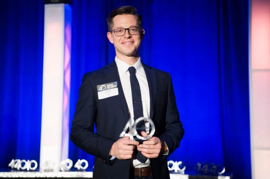 Joe Fox poses for a photo during the 40 Under 40 celebration and Book of Lists launch at the Knoxville Convention Center Thursday, Jan. 17, 2019.