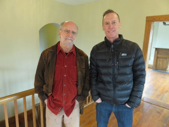 Tom Weiss, left, and Michael Wood inside the Lones-Dowell home.
