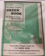 """The 1955 """"Green Book"""" cover for black traveling motorists."""