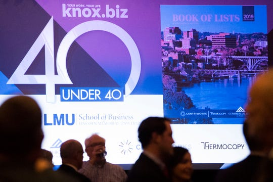 Attendees mingle during the 40 Under 40 celebration and Book of Lists launch at the Knoxville Convention Center Thursday, Jan. 17, 2019.