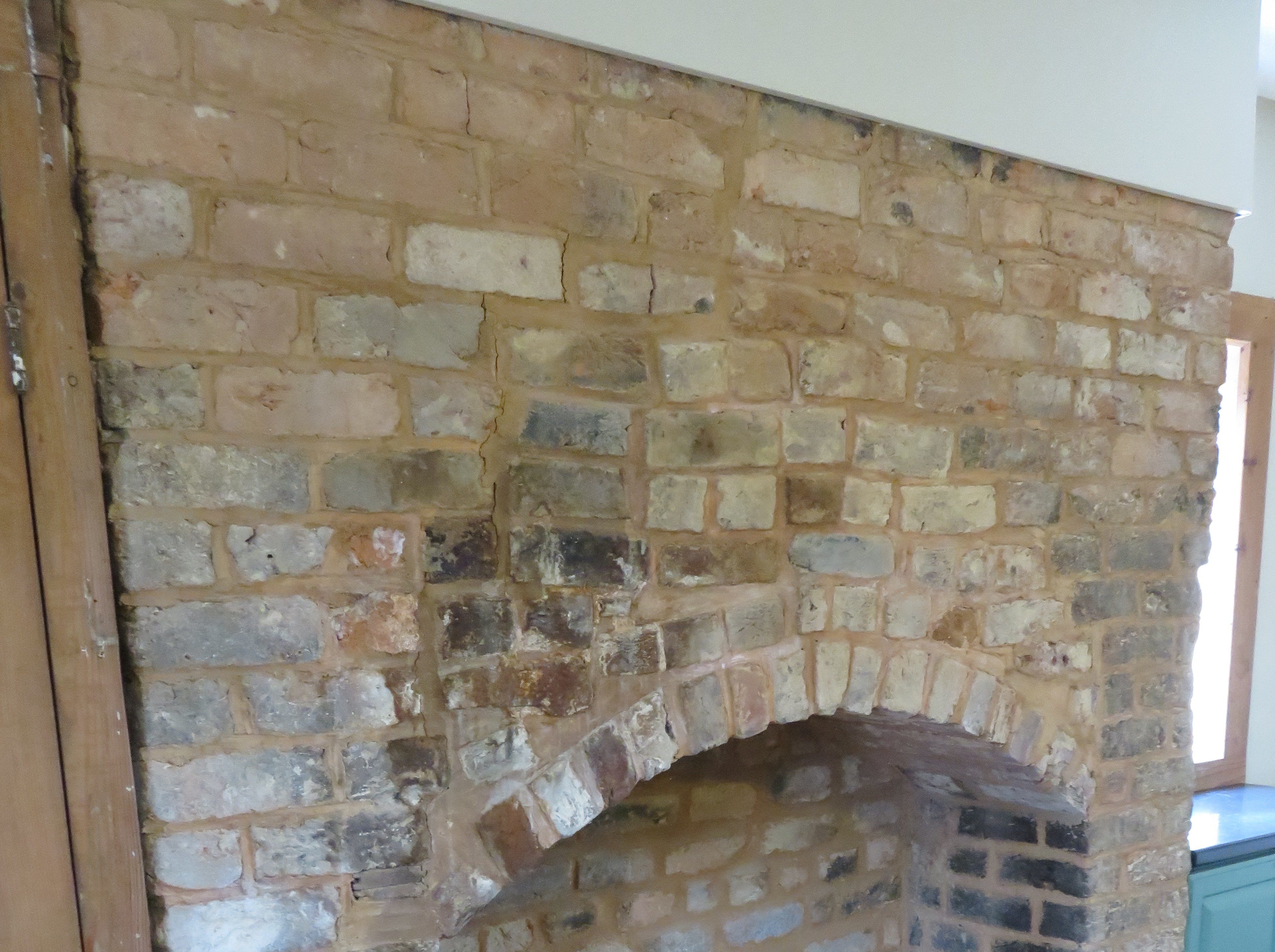 Largest former brick fireplace in Lones-Dowell home.