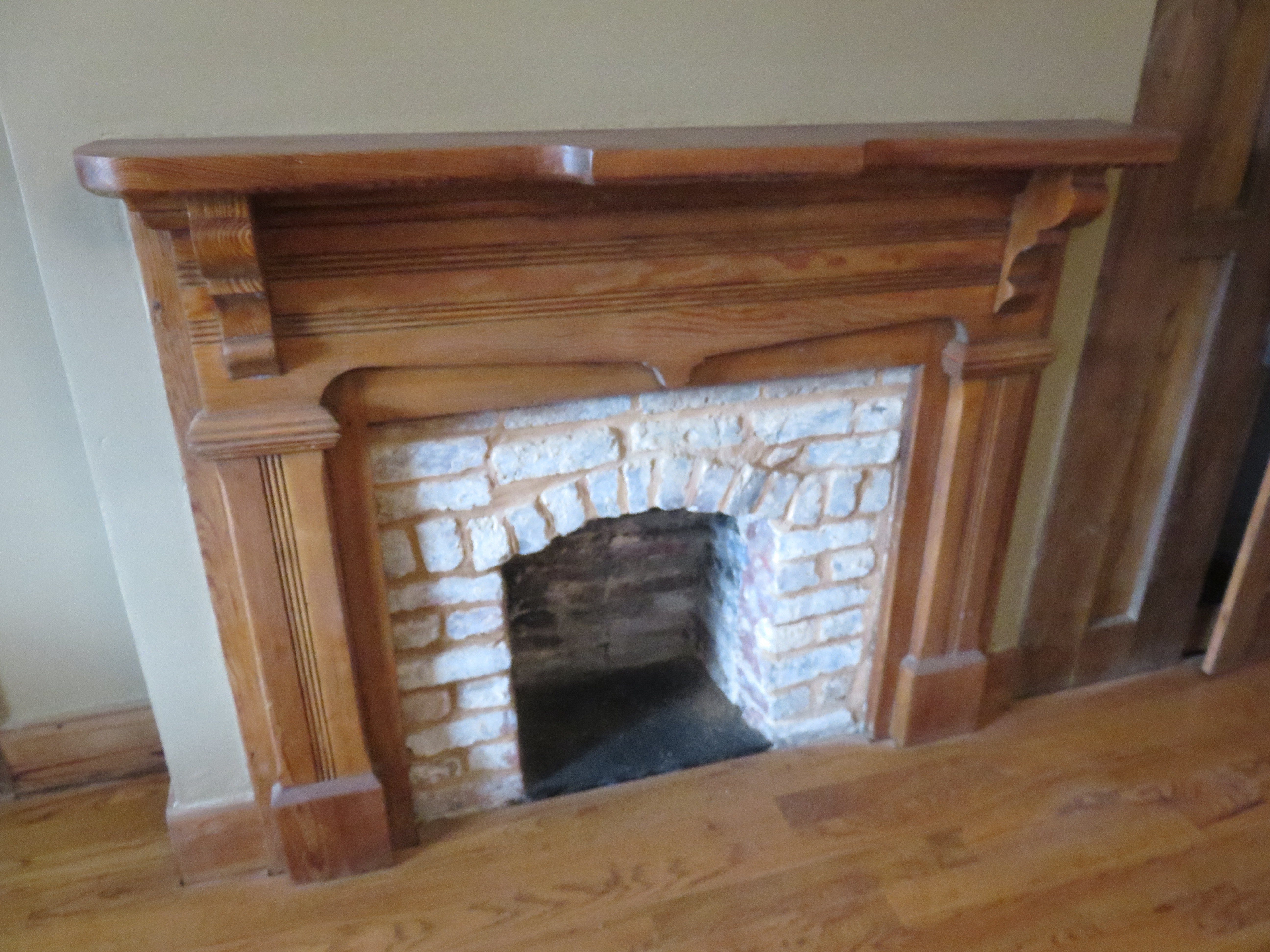 One of first-floor fireplaces and vintage mantels.