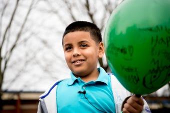 Carlos De La Rosa on releasing balloons for MLK Day