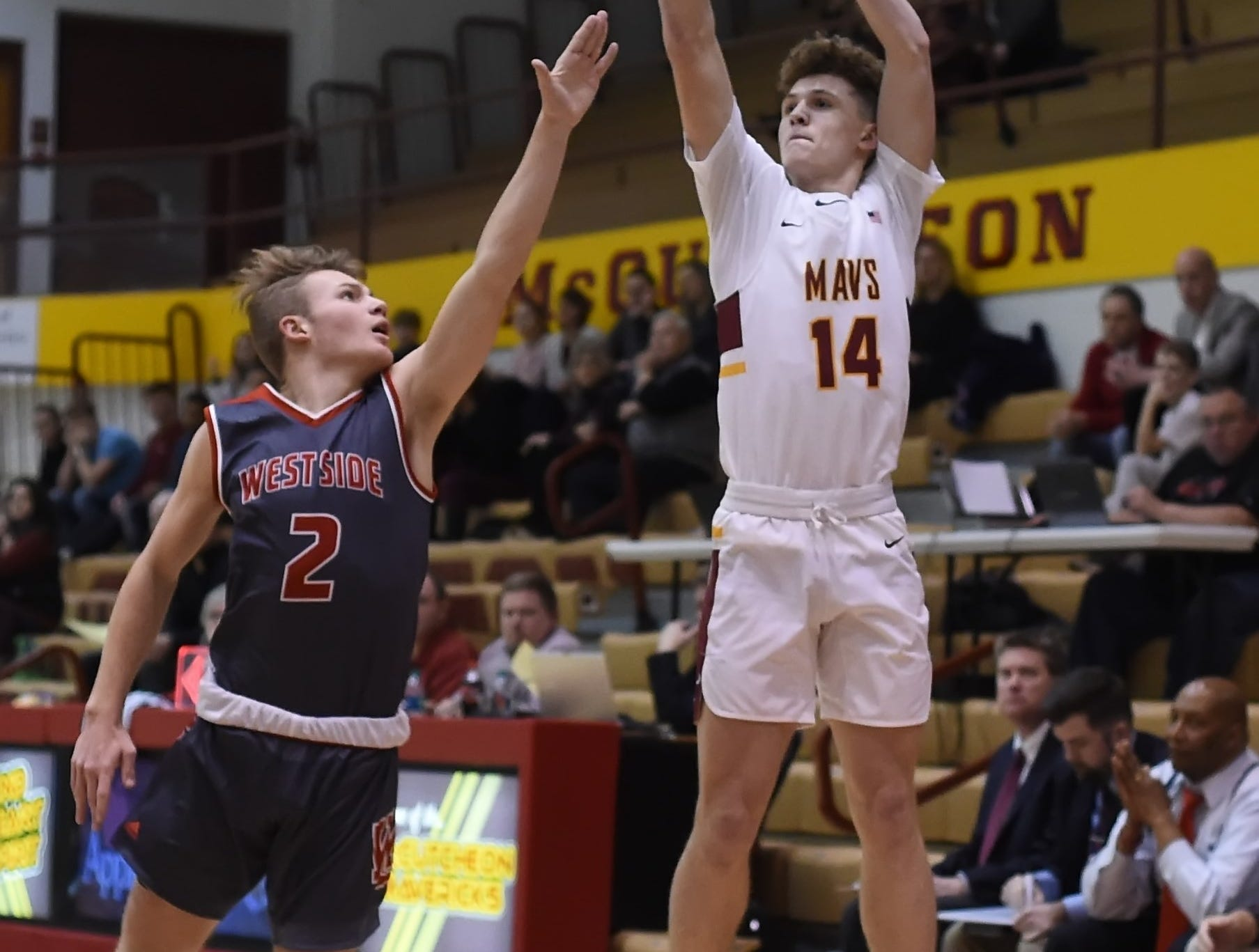 Scenes from Thursday night basketball action as the Mavericks of McCutcheon host the West Side Red Devils. Rowen Farrell.