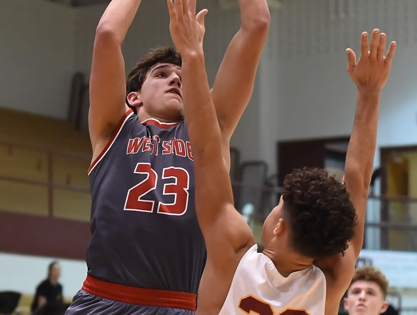 Scenes from Thursday night basketball action as the Mavericks of McCutcheon host the West Side Red Devils. Yanni Karlaftis.