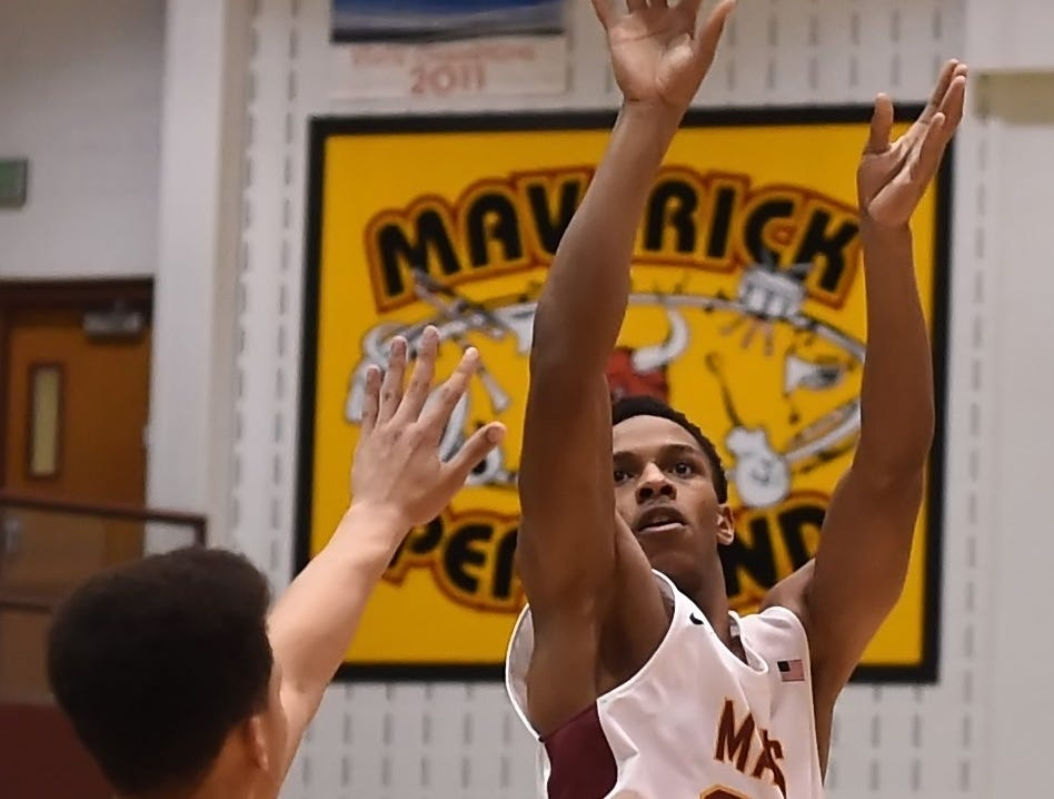 Scenes from Thursday night basketball action as the Mavericks of McCutcheon host the West Side Red Devils. Tonio McCurine.