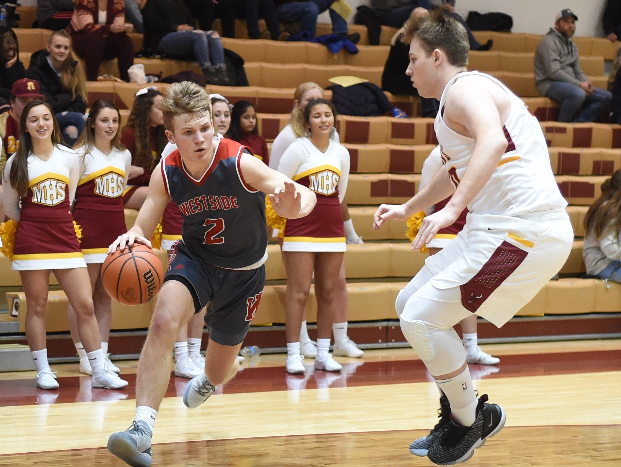 Scenes from Thursday night basketball action as the Mavericks of McCutcheon host the West Side Red Devils. Tyler Boyle.