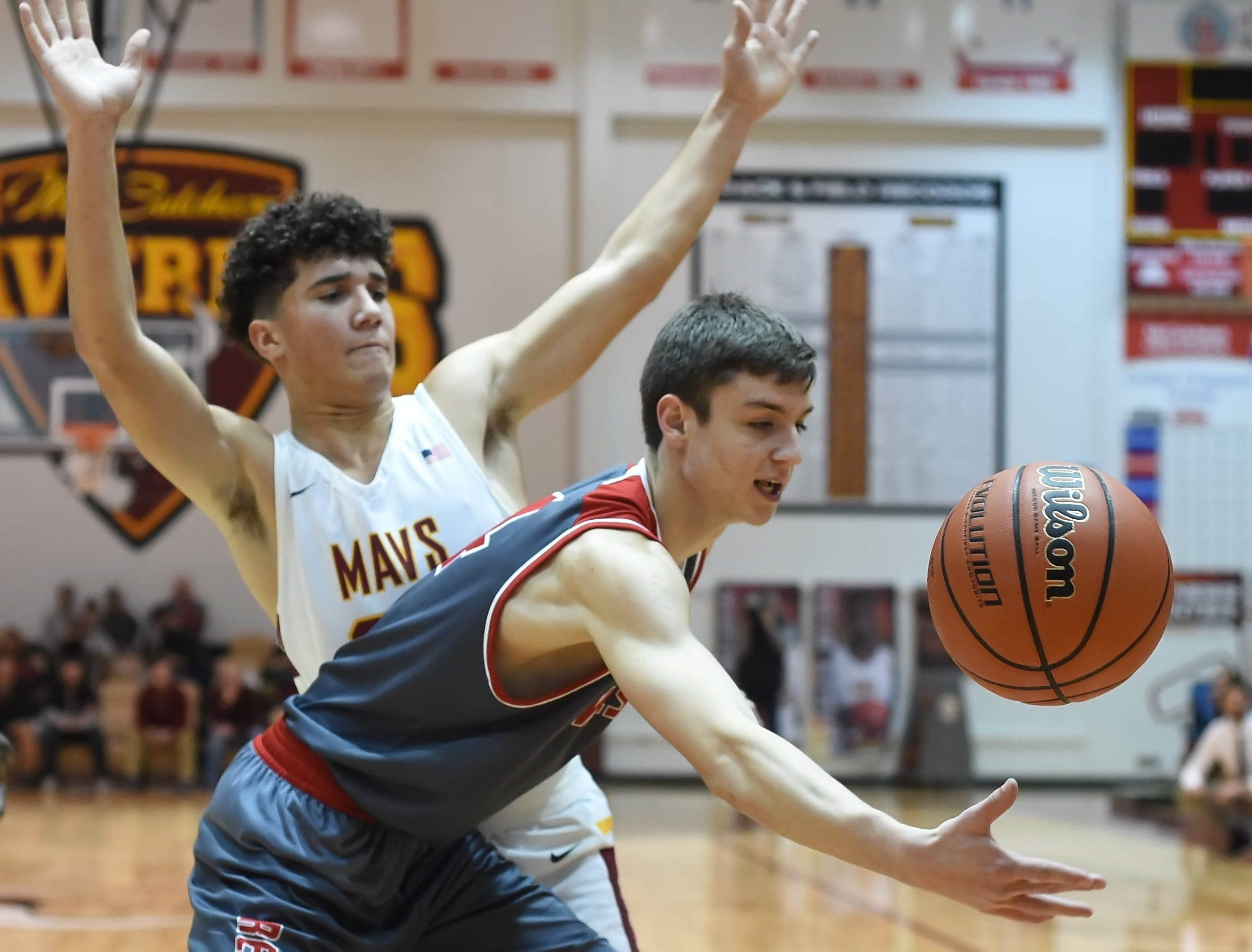 Scenes from Thursday night basketball action as the Mavericks of McCutcheon host the West Side Red Devils.