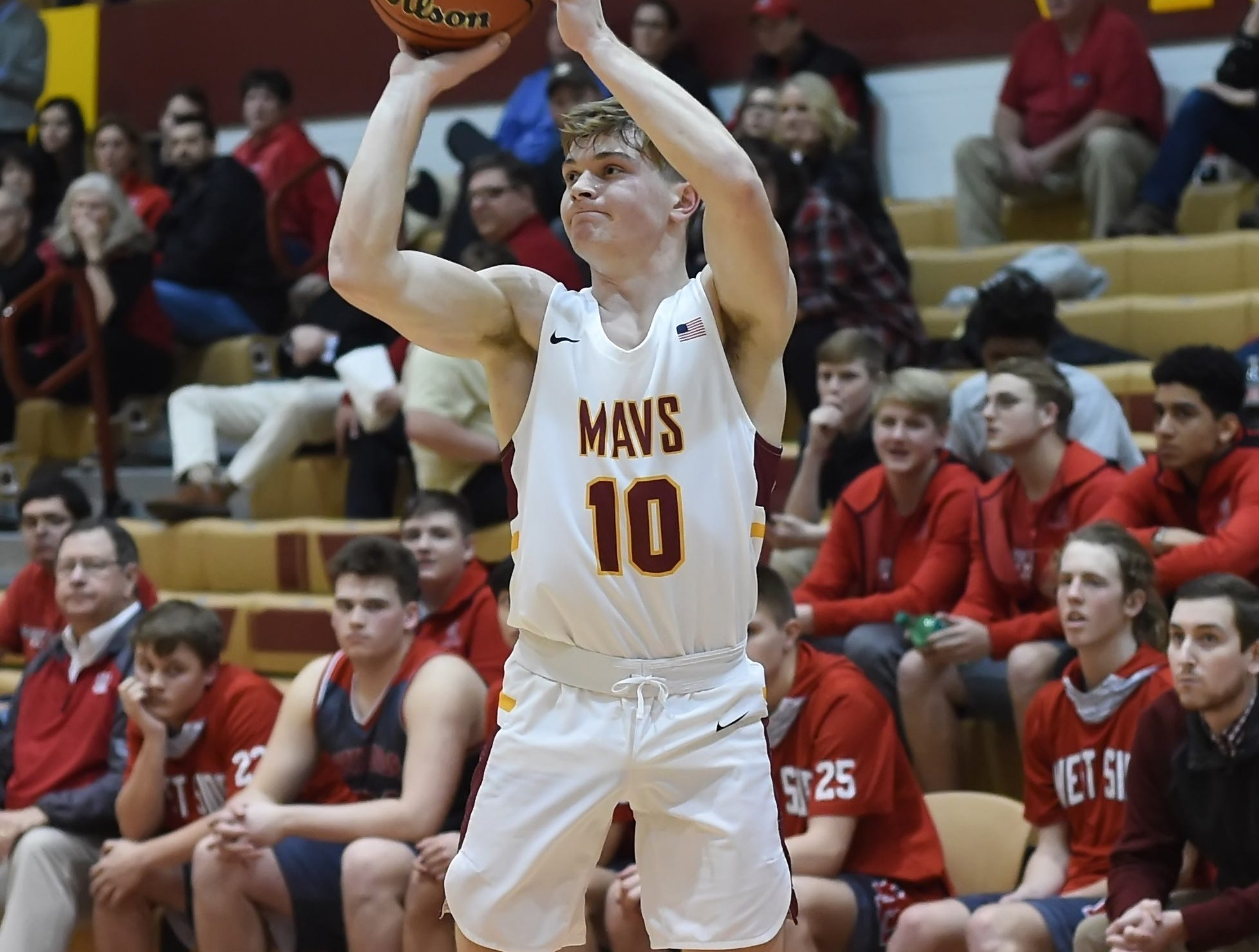 Scenes from Thursday night basketball action as the Mavericks of McCutcheon host the West Side Red Devils. Garrett Maish.
