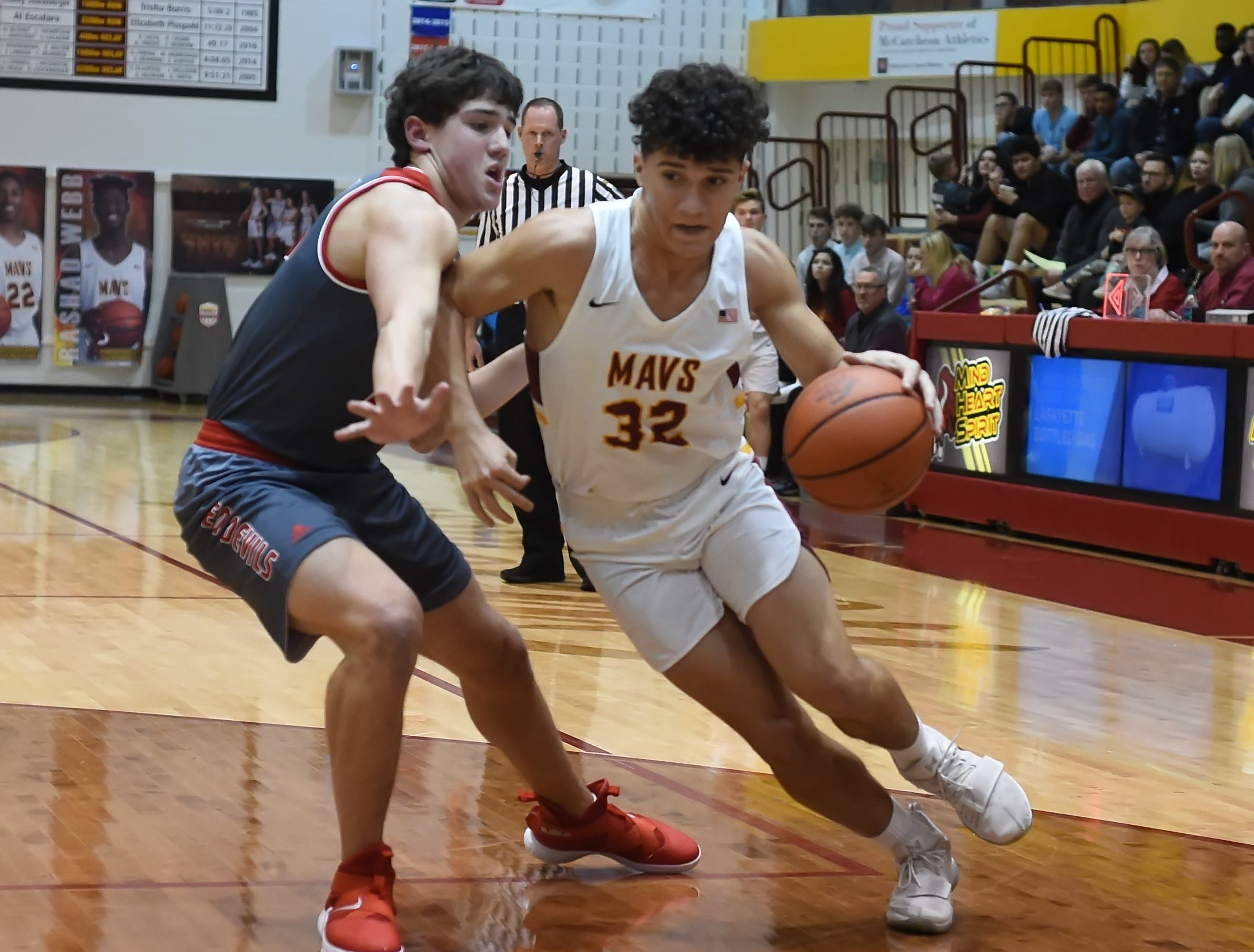 Scenes from Thursday night basketball action as the Mavericks of McCutcheon host the West Side Red Devils. Mason Douglas.