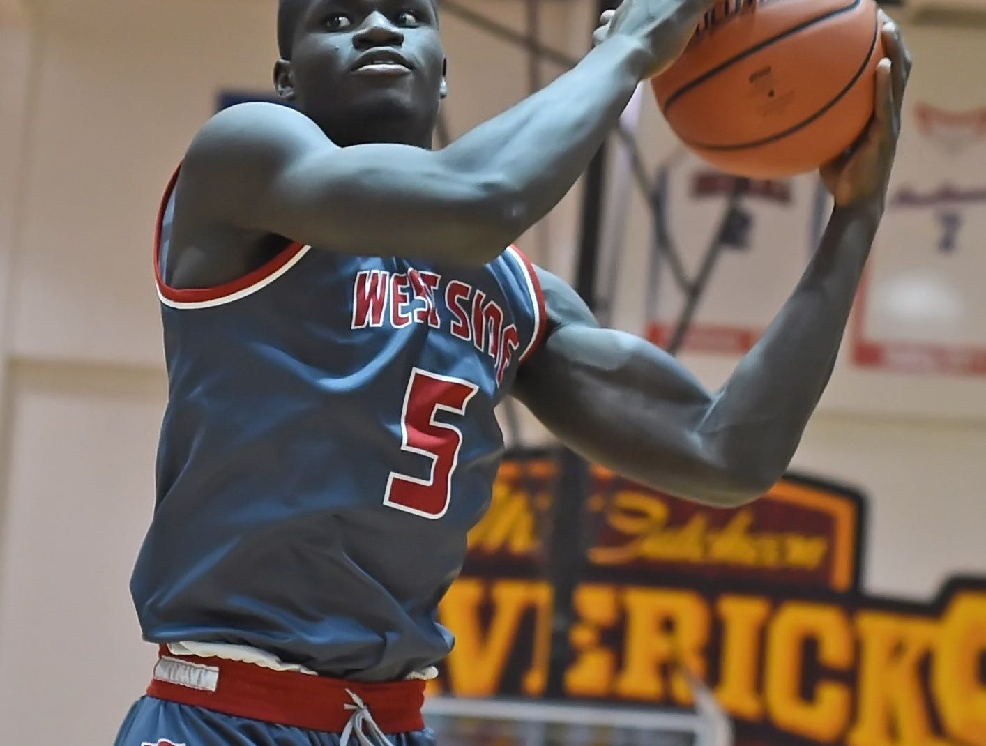 Scenes from Thursday night basketball action as the Mavericks of McCutcheon host the West Side Red Devils. Nelson Mbongo.