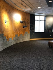 Part of the Purdue University Black Cultural Center historical installation features pseudo bricks, signifying the BCC's beginnings born from the demand of cultural change on the university's campus.