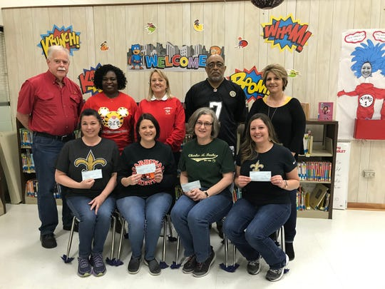 St. Basil Knights of Columbus Council No. 10721 donated to four Lafayette Parish school libraries on Jan. 18, 2019.