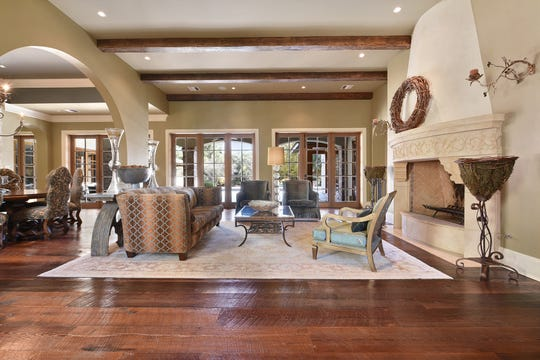 Luxurious floors and finishes are featured throughout the home.