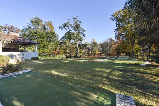The home includes a putting green and magnificent view of the Vermilion River.