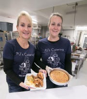 Pam Russell, left, and Jody Seagraves, who co-own PJ's Catering in Howell, prepared oven-fried chicken dinners and cake for takeout customers, Friday, Jan. 18, 2019.