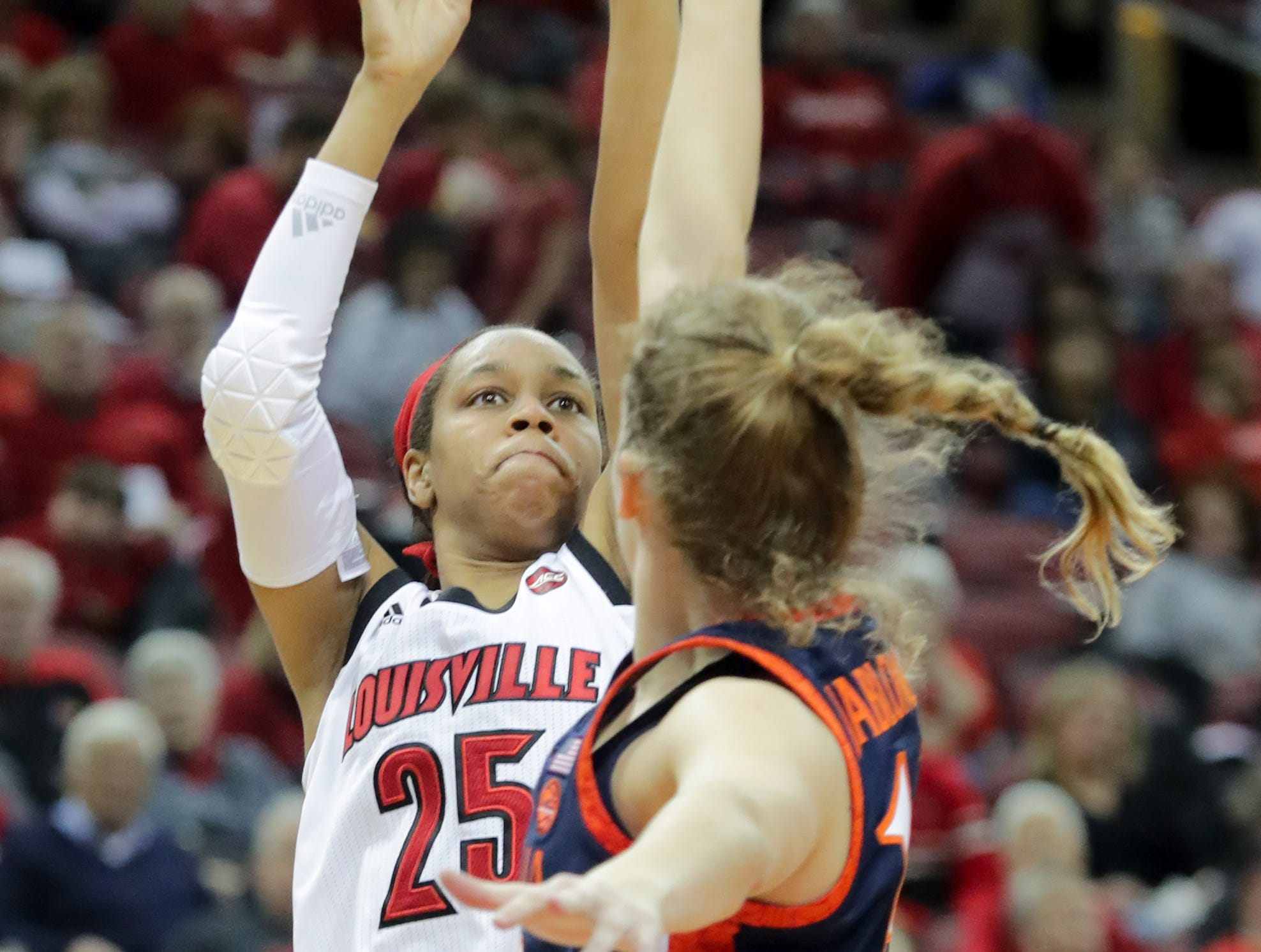 Louisville's Asia Durr knocks down a shot over Virginia's