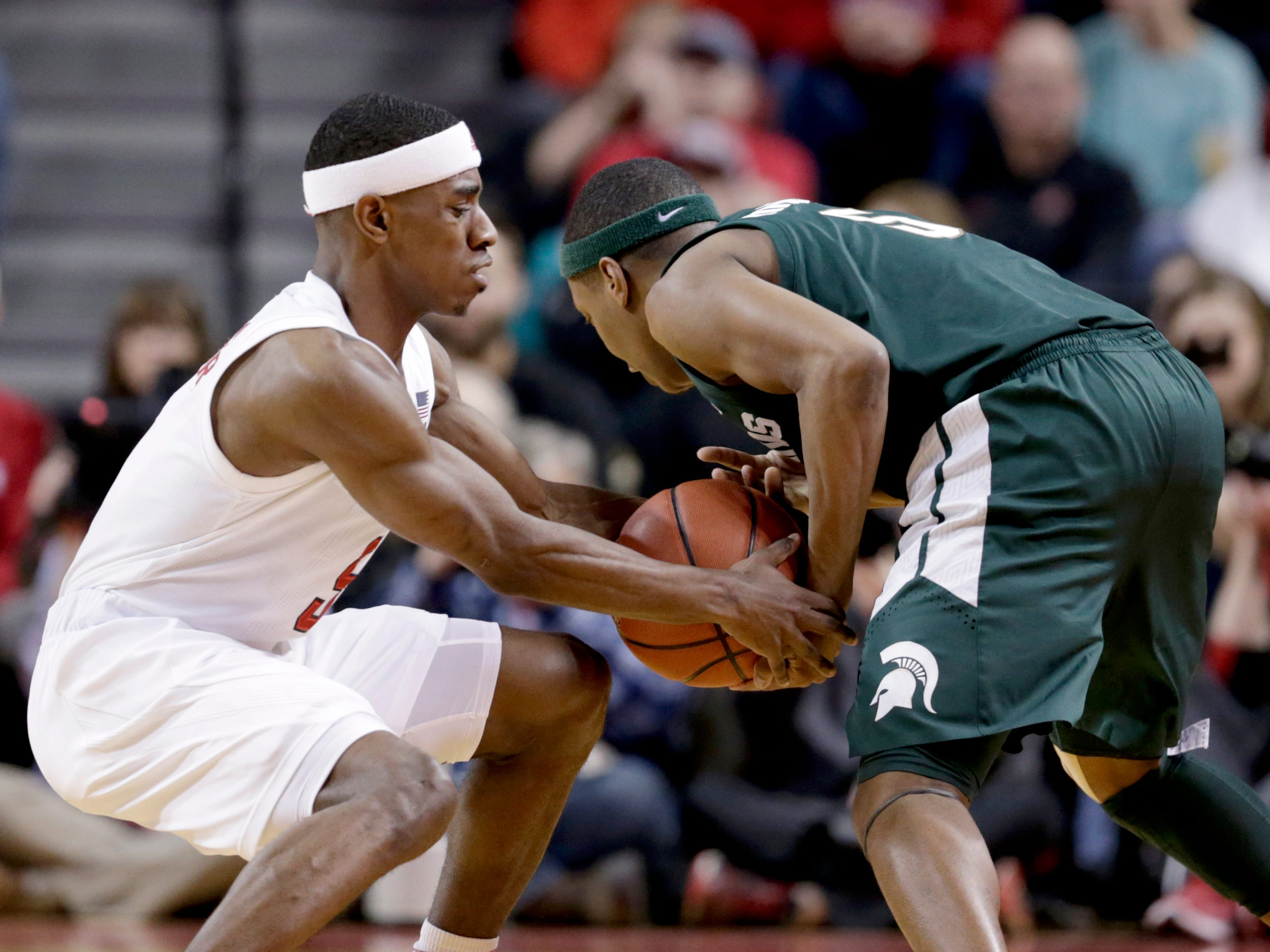 Nebraska's Glynn Watson Jr., left, steals the ball from Michigan State's Cassius Winston (5) during the first half of an NCAA college basketball game in Lincoln, Neb., Thursday, Jan. 17, 2019.