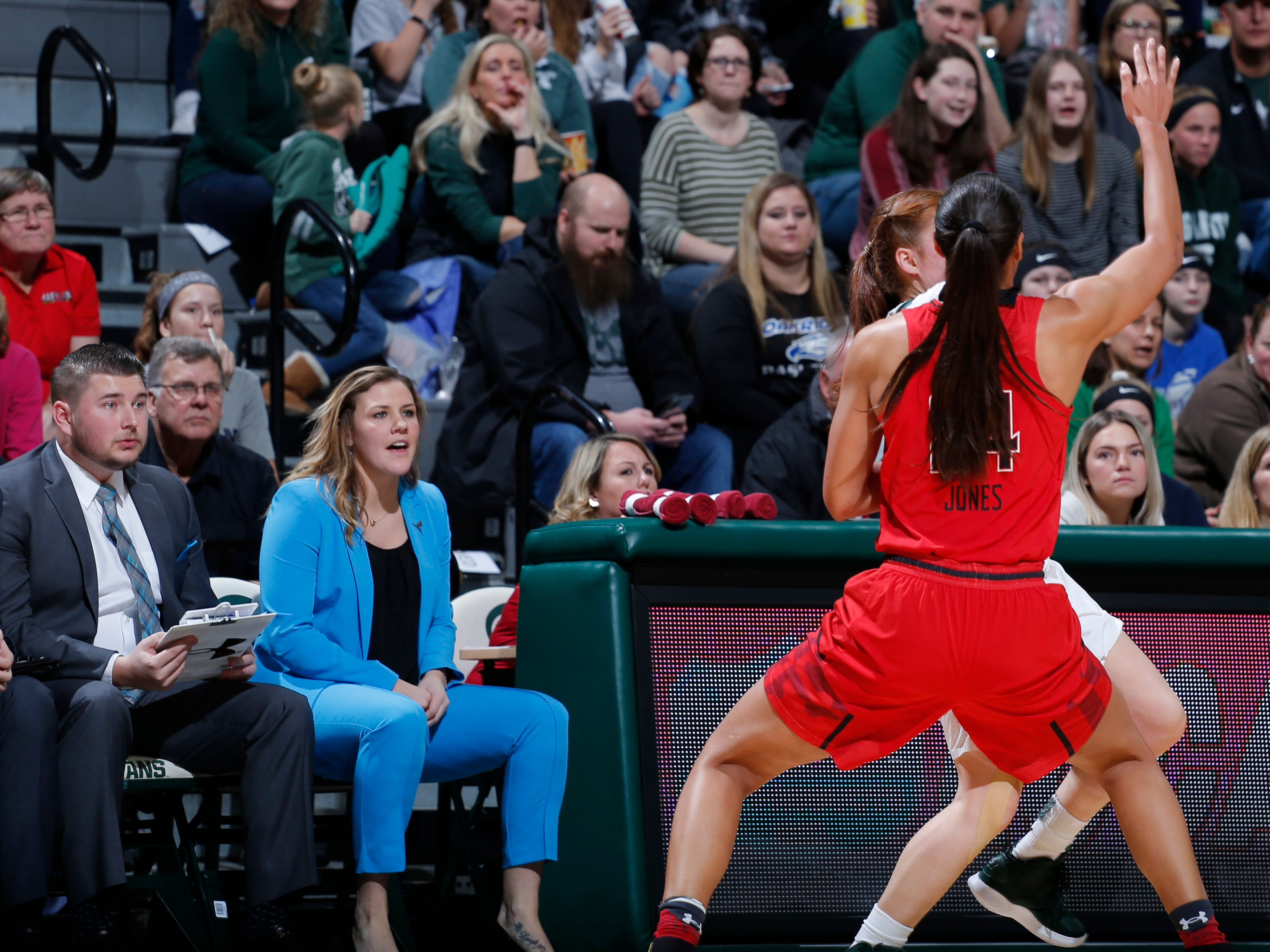Former Michigan State player Tori Jankoska, now with Maryland, watches from the Maryland bench, Thursday, Jan. 17, 2019, in East Lansing, Mich.