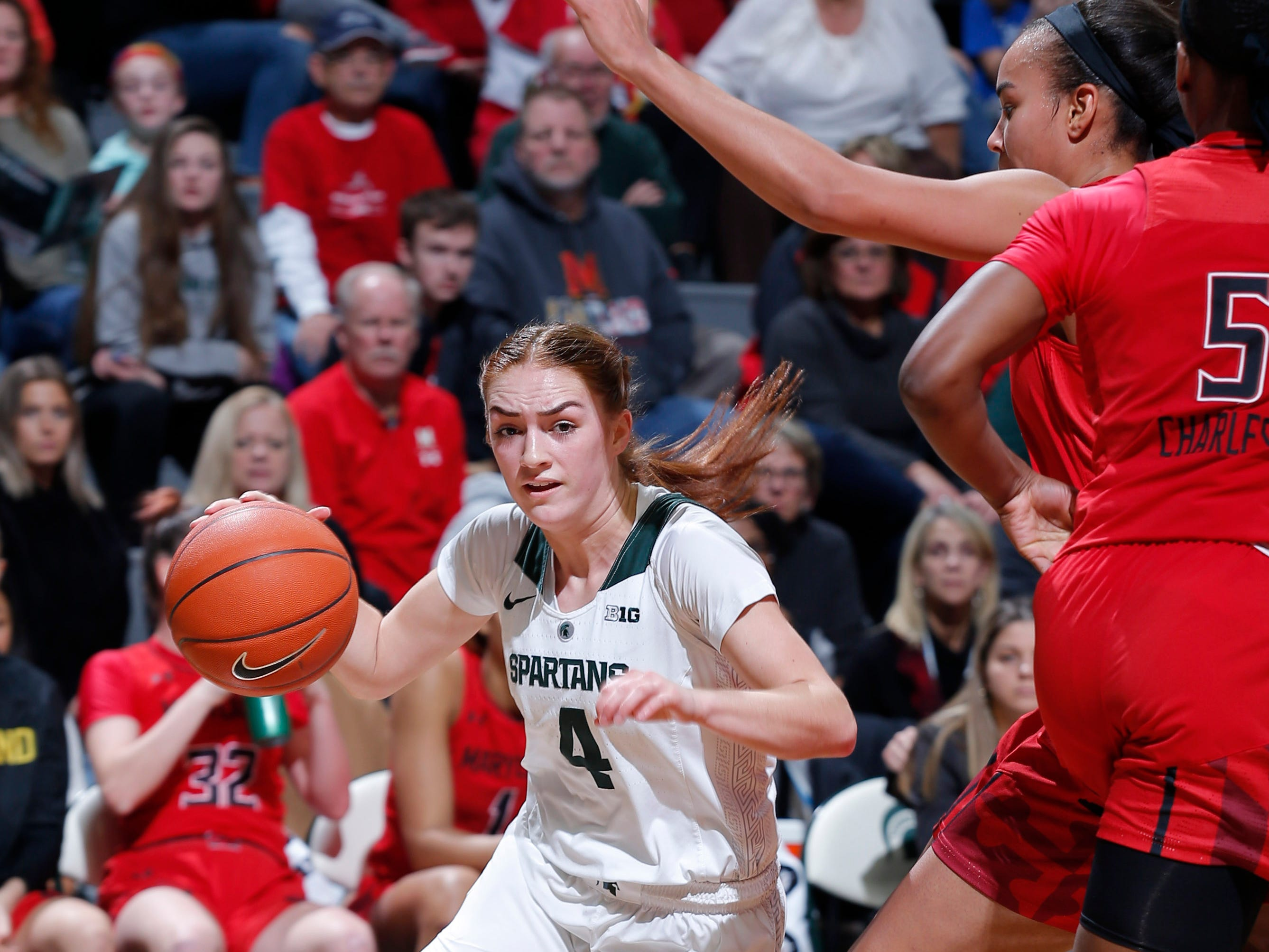 Michigan State's Taryn McCutcheon, left, drives against Maryland, Thursday, Jan. 17, 2019, in East Lansing, Mich.