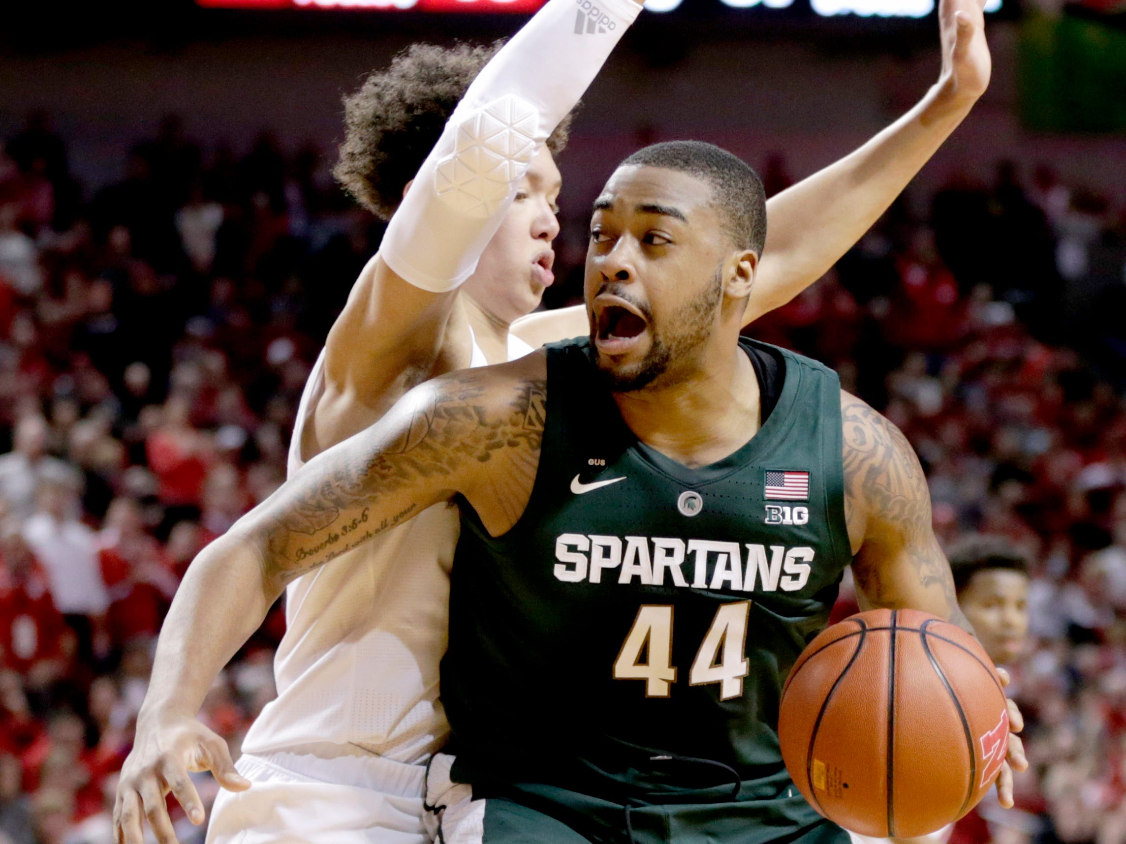 Michigan State's Nick Ward (44) is defended by Nebraska's Isaiah Roby, rear, during the second half of an NCAA college basketball game in Lincoln, Neb., Thursday, Jan. 17, 2019. Michigan State won 70-64.