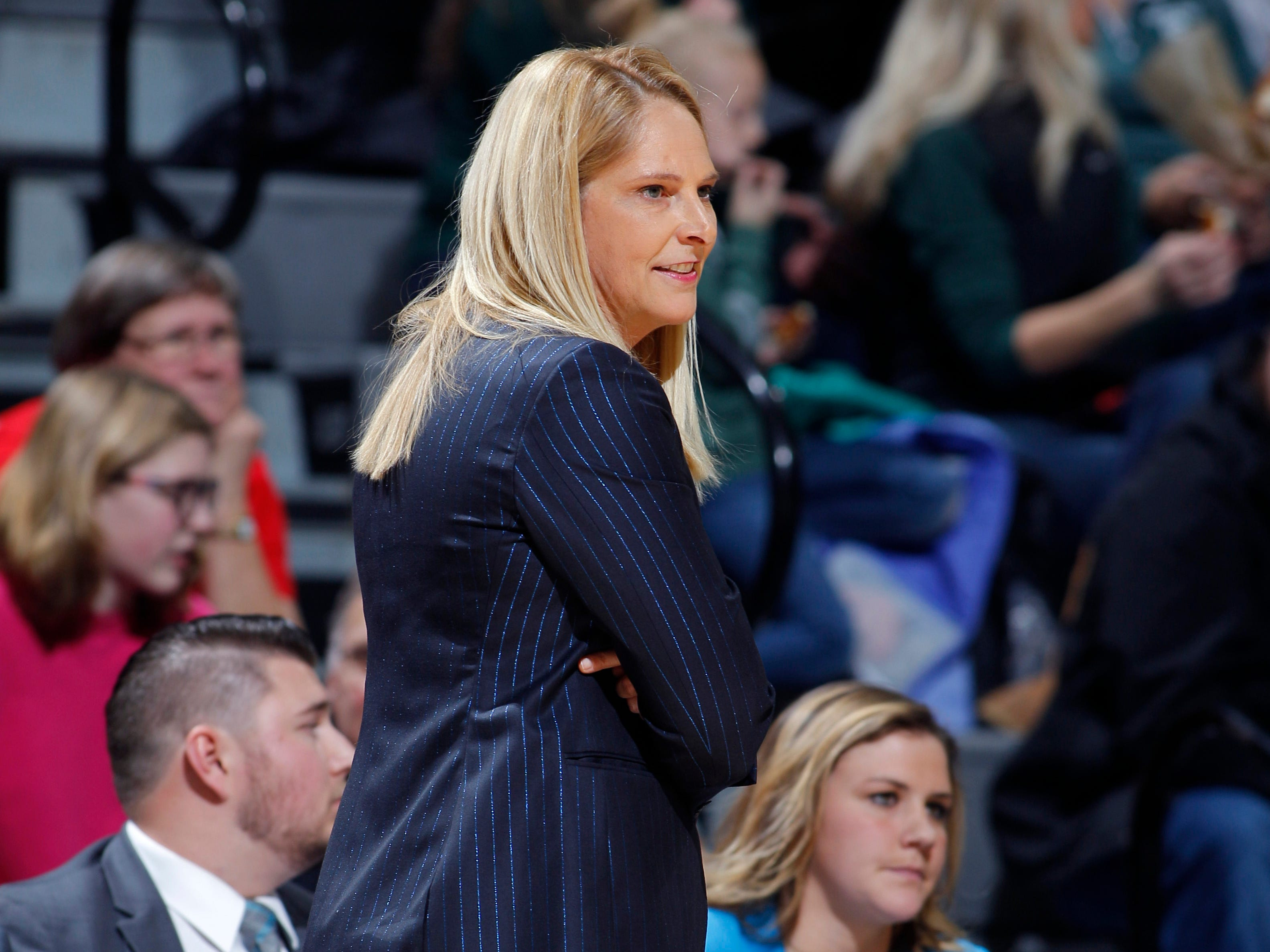 Former Michigan State player Tori Jankoska, right, now with Maryland, watches from the Maryland bench as Maryland head coach Brenda Frese walks the sideline, Thursday, Jan. 17, 2019, in East Lansing, Mich.