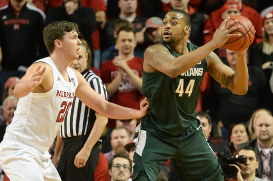 Michigan State's Nick Ward surveys the court before driving on Nebraska's Tanner Borchardt on Thursday night. Ward finished with 15 points and 10 rebounds.