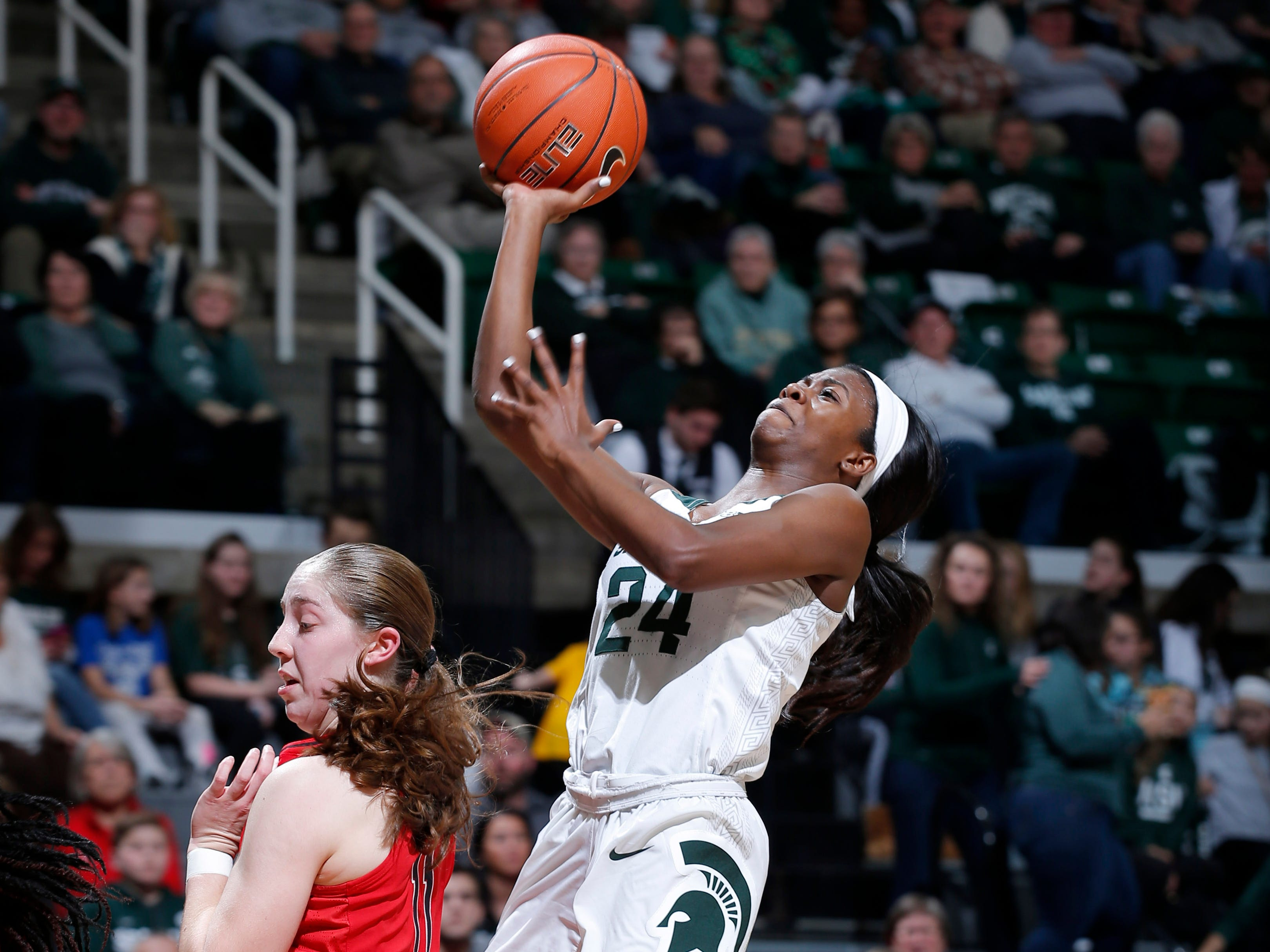 Michigan State's Nia Clouden, right, puts up s driving shot against Maryland's Taylor Mikesell, Thursday, Jan. 17, 2019, in East Lansing, Mich.