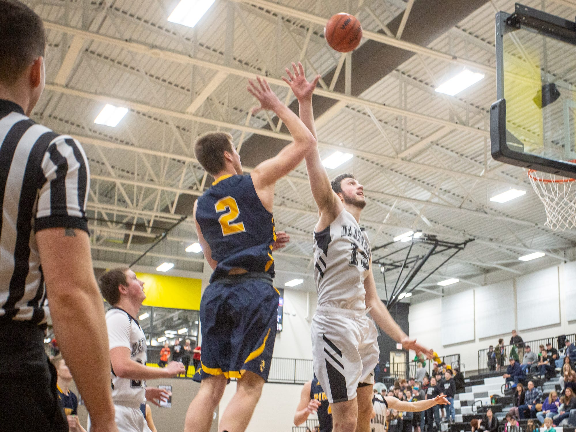 Dansville senior Caleb Hodgson blocks a shot by Pewamo-Westphalia's Nathan Wirth on Thursday, Jan. 17, 2019.