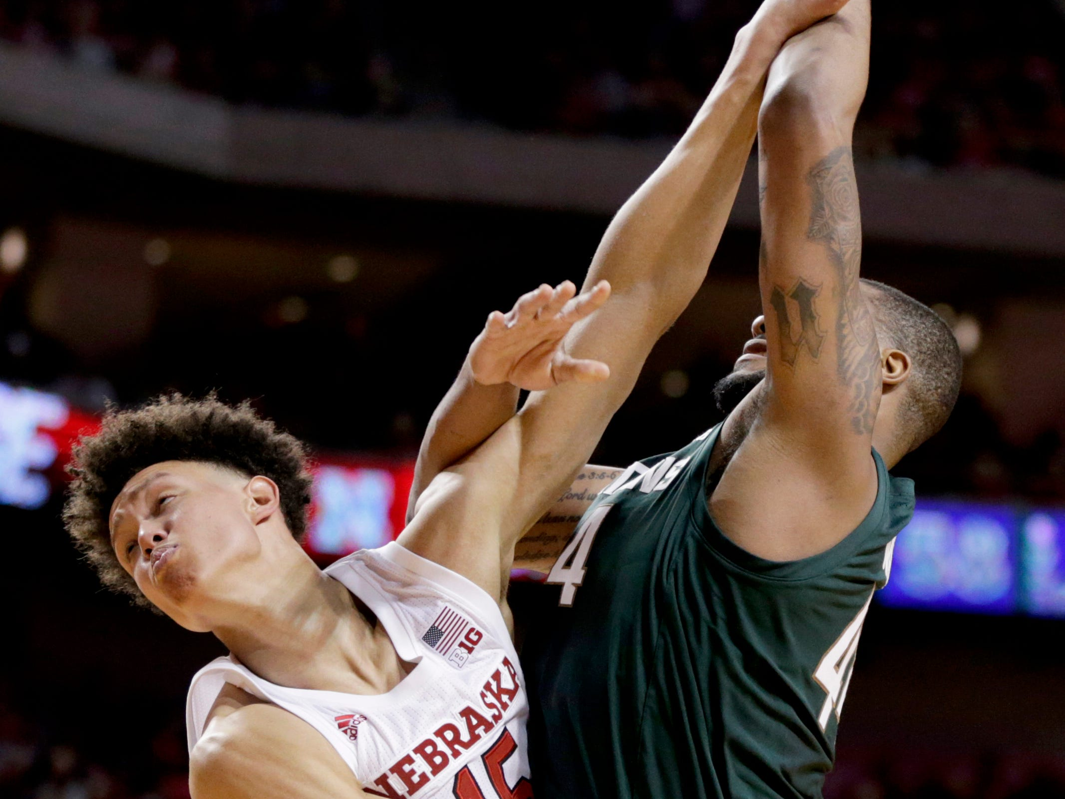 Nebraska's Isaiah Roby (15) commits his fifth foul as he tries to block a shot by Michigan State's Nick Ward (44) during the second half of an NCAA college basketball game in Lincoln, Neb., Thursday, Jan. 17, 2019. Michigan State won 70-64.