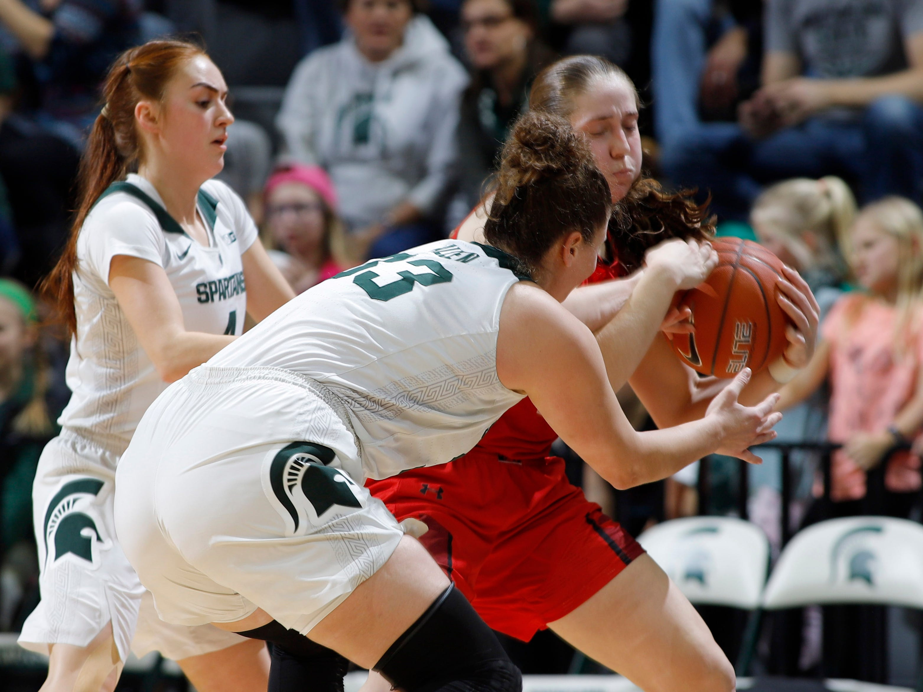Michigan State's Jenna Allen, center, and Taryn McCutcheon, left, pressure Maryland's Taylor Mikesell, Thursday, Jan. 17, 2019, in East Lansing, Mich.