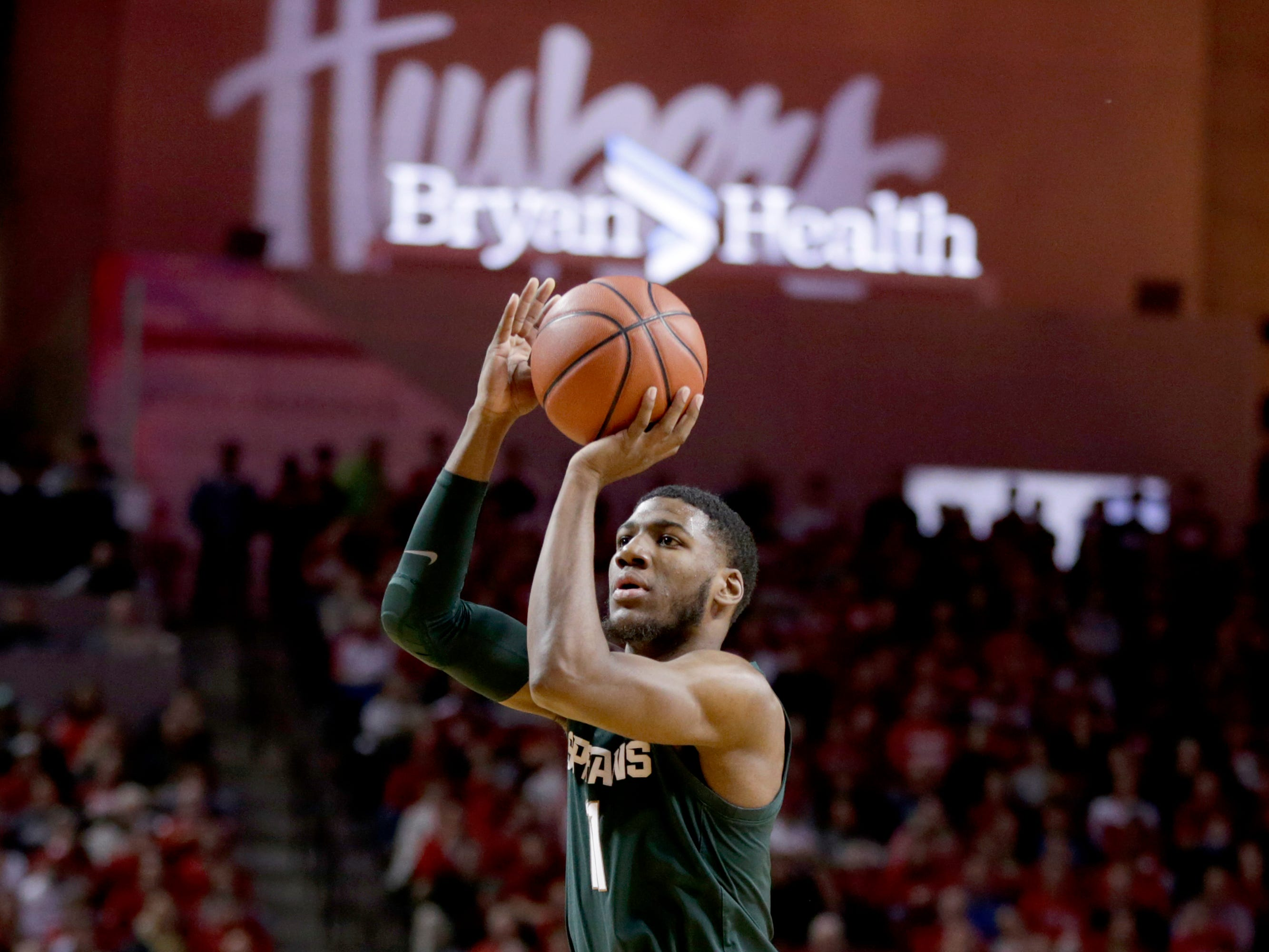 Michigan State's Aaron Henry (11) shoots during the second half of an NCAA college basketball game against Nebraska in Lincoln, Neb., Thursday, Jan. 17, 2019. Michigan State won 70-64.