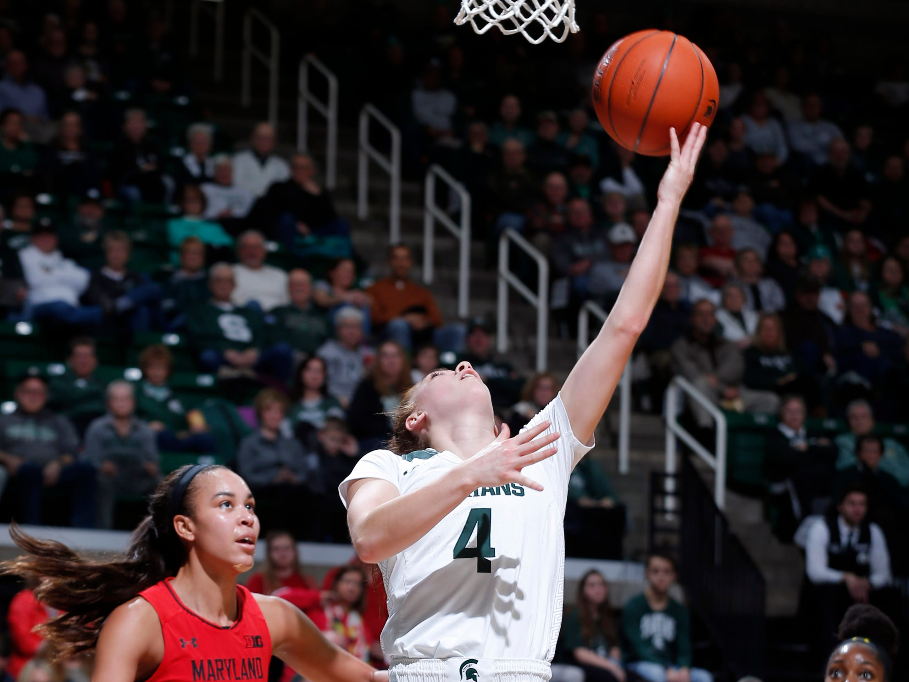 Michigan State's Taryn McCutcheon gets a reverse layup against Maryland's Stephanie Jones, left, and Kaila Charles, right, Thursday, Jan. 17, 2019, in East Lansing, Mich.