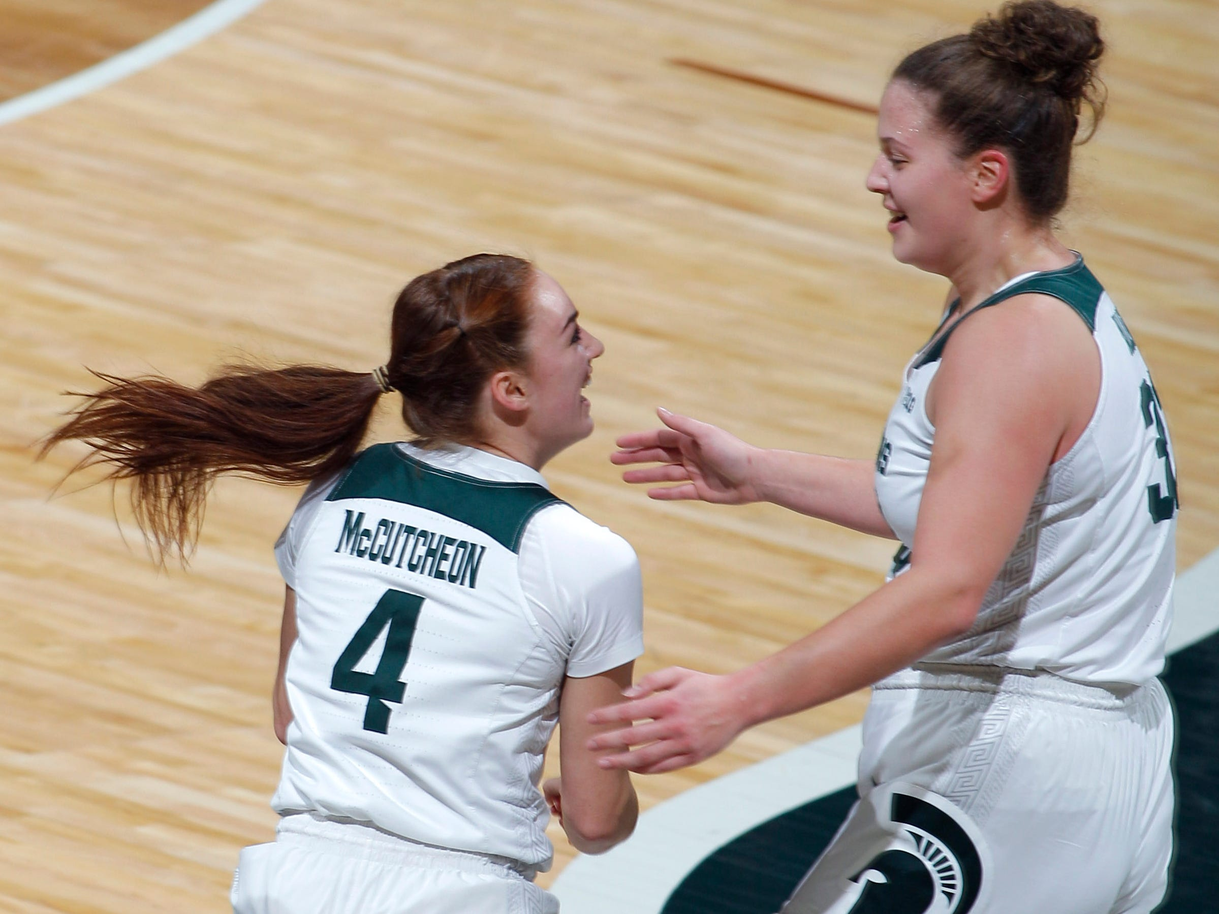 Michigan State's Taryn McCutcheon, left, and Jenna Allen celebrate against Maryland, Thursday, Jan. 17, 2019, in East Lansing, Mich.