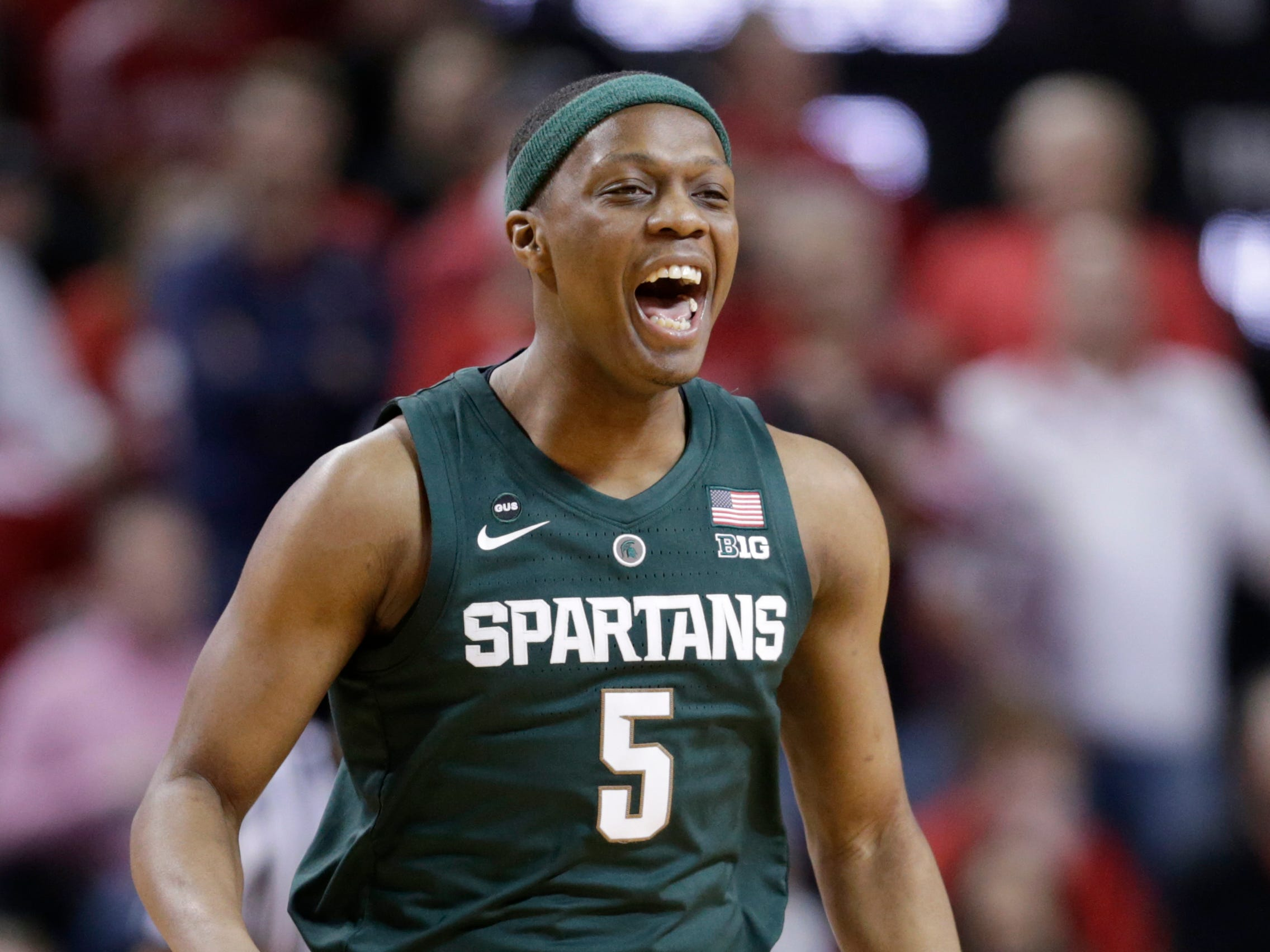 Michigan State's Cassius Winston (5) reacts after scoring a 3-point shot during the first half of an NCAA college basketball game against Nebraska in Lincoln, Neb., Thursday, Jan. 17, 2019.
