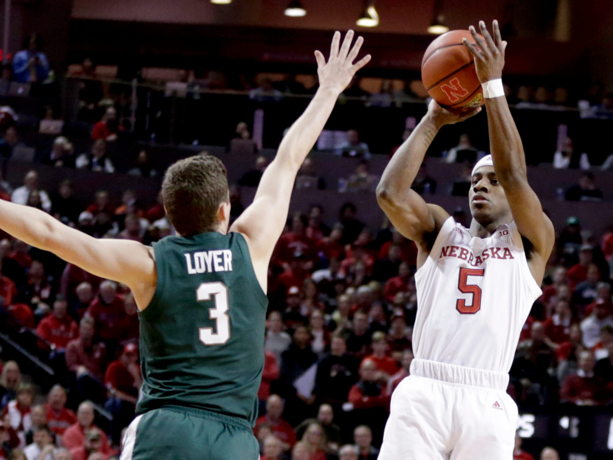 Nebraska's Glynn Watson Jr. (5) shoots over Michigan State's FosterLoyer (3) during the first half of an NCAA college basketball game in Lincoln, Neb., Thursday, Jan. 17, 2019.