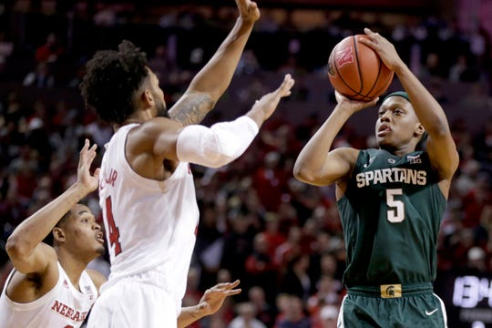 Michigan State's Cassius Winston shoots over Nebraska's James Palmer, left, and Isaac Copeland, right, during the Spartans' 70-64 win Thursday night.