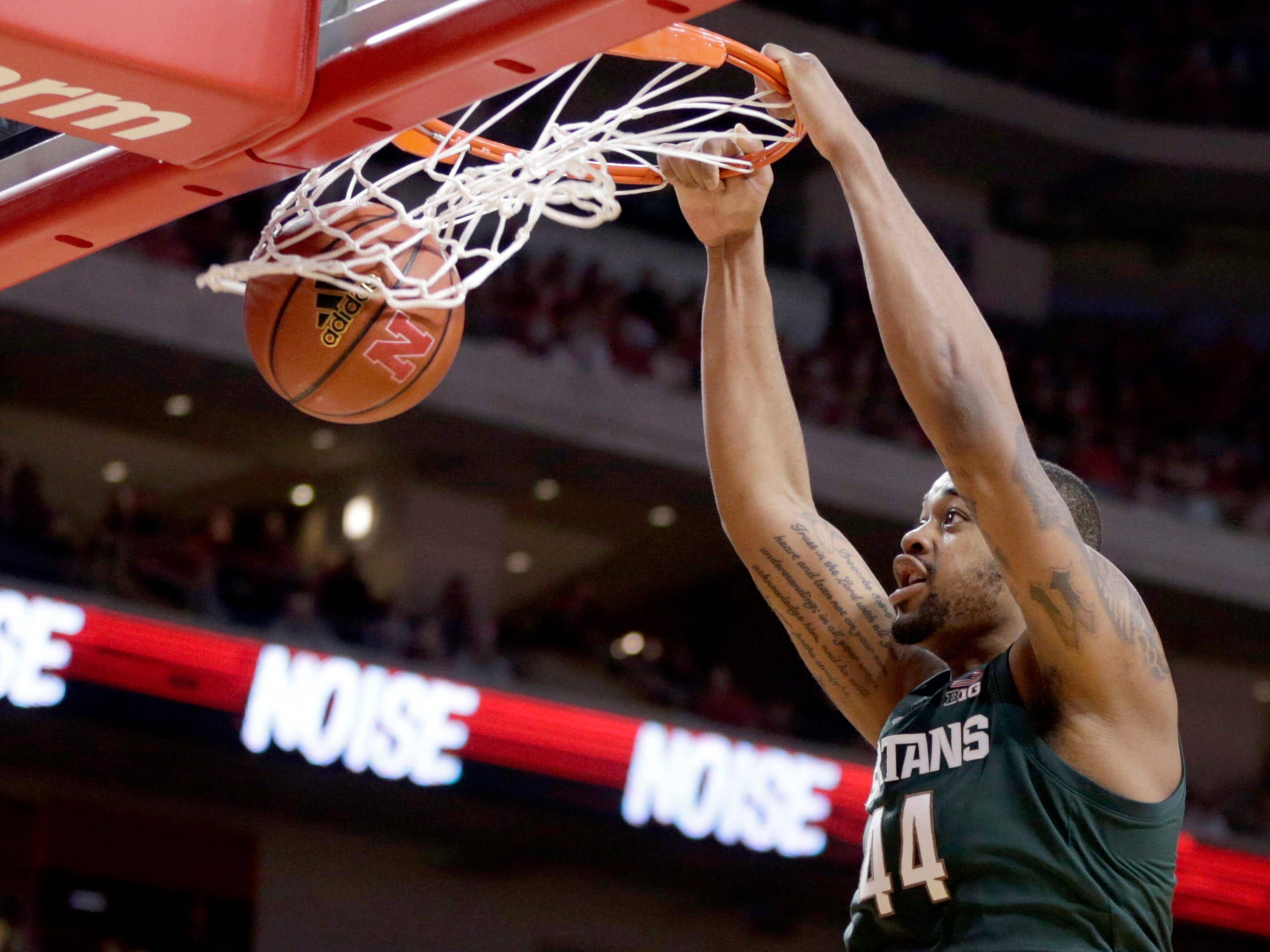 Michigan State's Nick Ward (44) dunks as Nebraska's Isaiah Roby (15) watches during the second half of an NCAA college basketball game in Lincoln, Neb., Thursday, Jan. 17, 2019. Michigan State won 70-64.