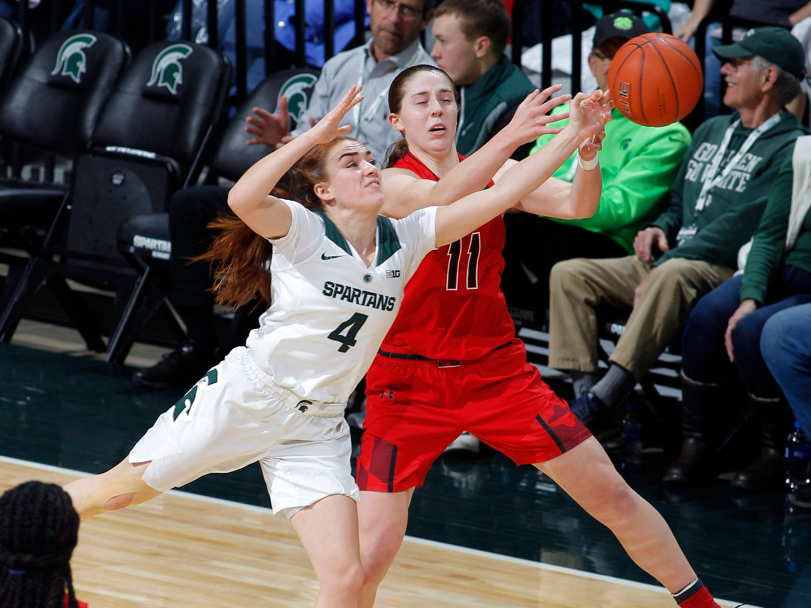Michigan State's Taryn McCutcheon (4) steals a pass away from Maryland's Taylor Mikesell, Thursday, Jan. 17, 2019, in East Lansing, Mich.