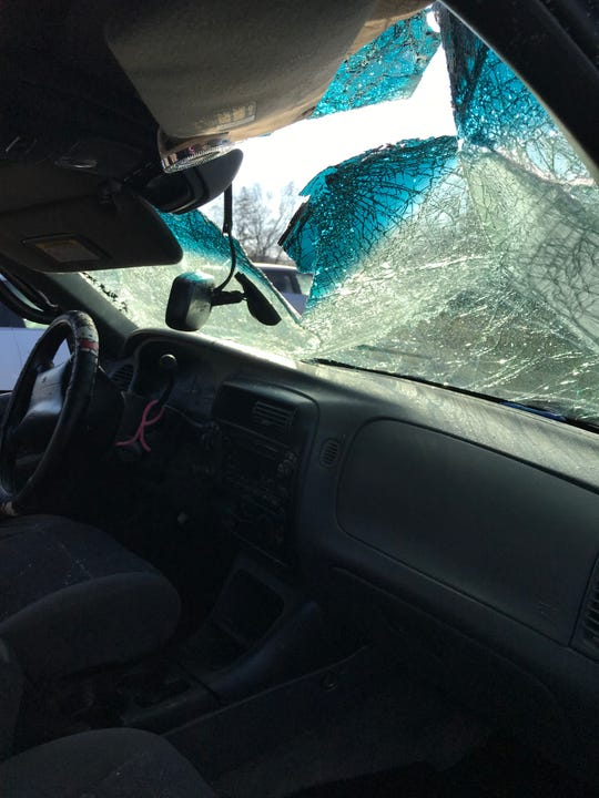 The crushed windshield of Diamond Parson's 2000 Ford Explorer. The vehicle was totaled in a Jan. 13, 2019 crash.