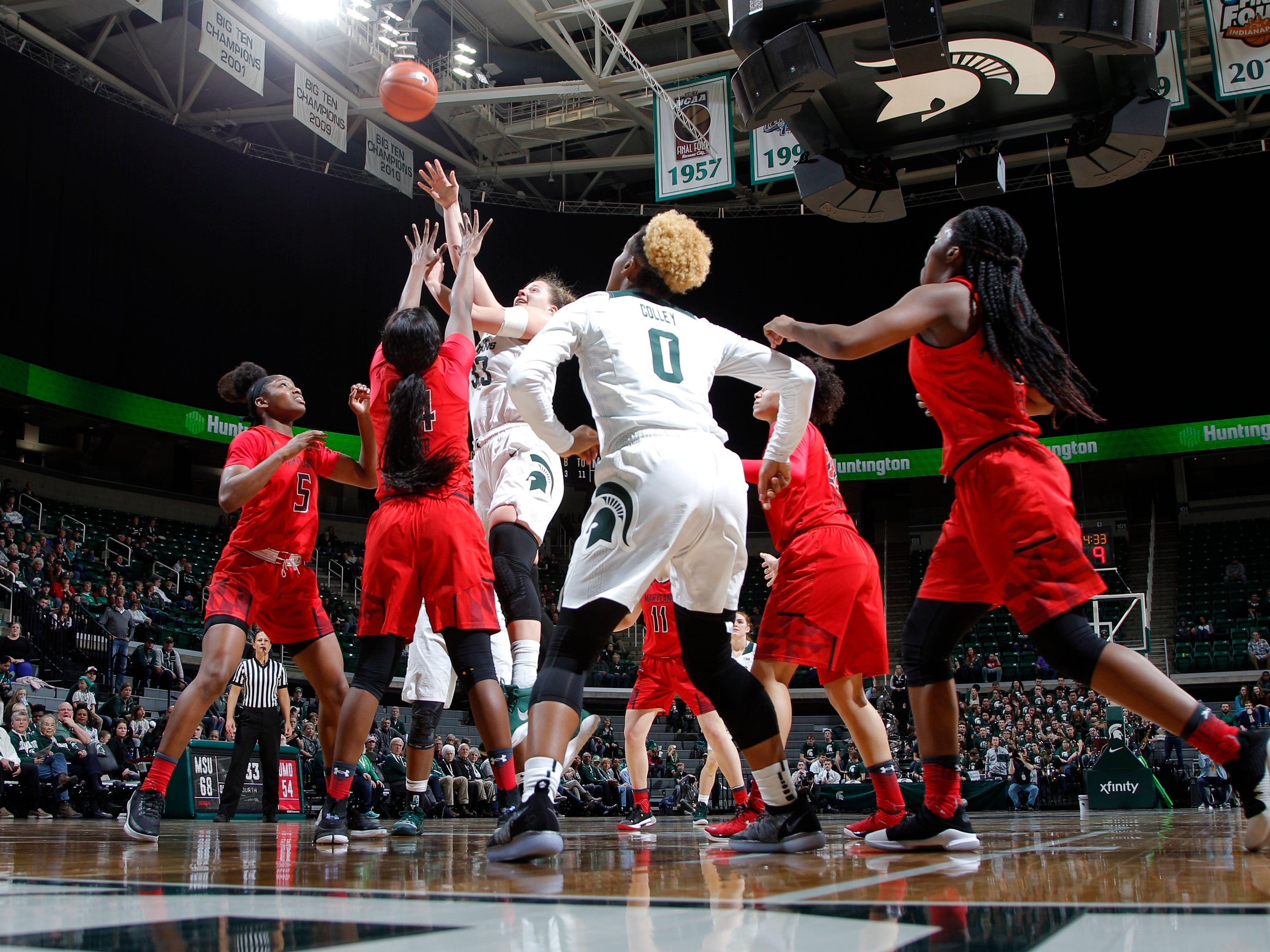Michigan State's Jenna Allen (33) shoots against Maryland's Brianna Fraser, Thursday, Jan. 17, 2019, in East Lansing, Mich.