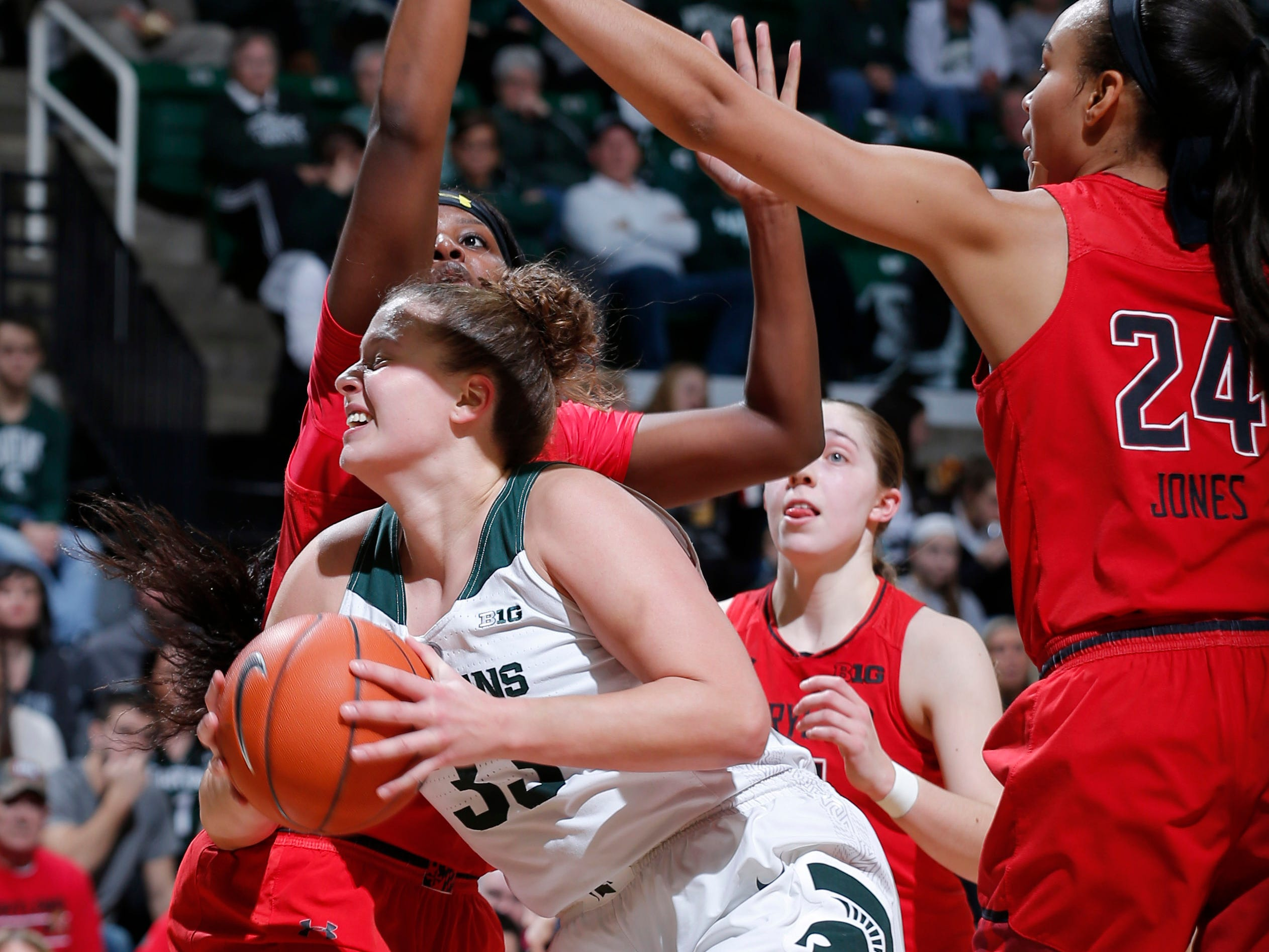 Michigan State's Jenna Allen looks for a shot against Maryland's Stephanie Jones, right, and Briana Fraser, Thursday, Jan. 17, 2019, in East Lansing, Mich.